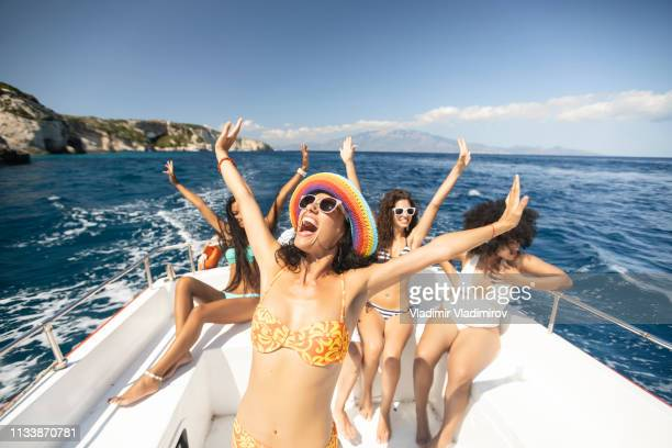 group of friends yachting and having fun - yacht stock pictures, royalty-free photos & images