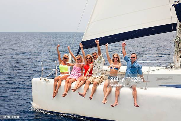 group of friends yelling and enjoying sailing catamaran - catamaran stock photos and pictures