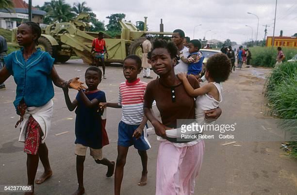 A group of frightened children flee as forces from the National Patriotic Front of Liberia advance through Congo Town Responding to years of...