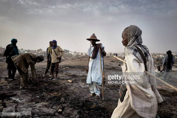 A group of Fulani displaced people work to rebuild a hut in the camp of Faladie on April 29 2020 On April 28 a fire ravaged the camp burning much of...