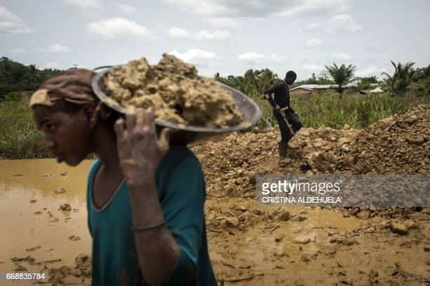 A group of Galamseyer illegal gold panners from Niger works in Kibi area southern Ghana on April 10 2017 These groups can range from 50 men to small...