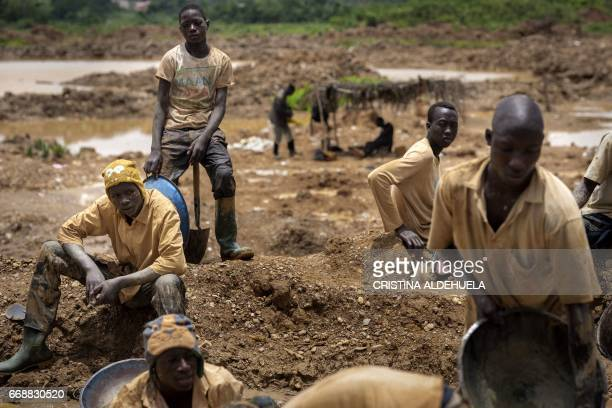 A group of Galamseyer illegal gold panners work in Kibi area southern Ghana on April 10 2017 These groups can range from 50 men to small ones of 5...