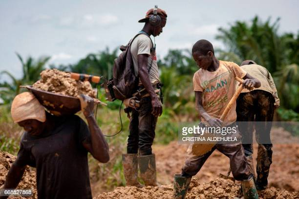 A group of Galamseyers illegal gold panner work on a gold field in Kibi on April 10 2017 Ghanaian government has decided to put an end to Galamsey...