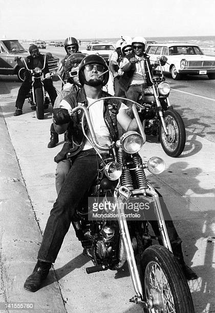 A group of Galveston 'Bandidos' or Texan boys who are inspired by the Californiabased Black Angels gang sitting on their motorcycles Texas USA...