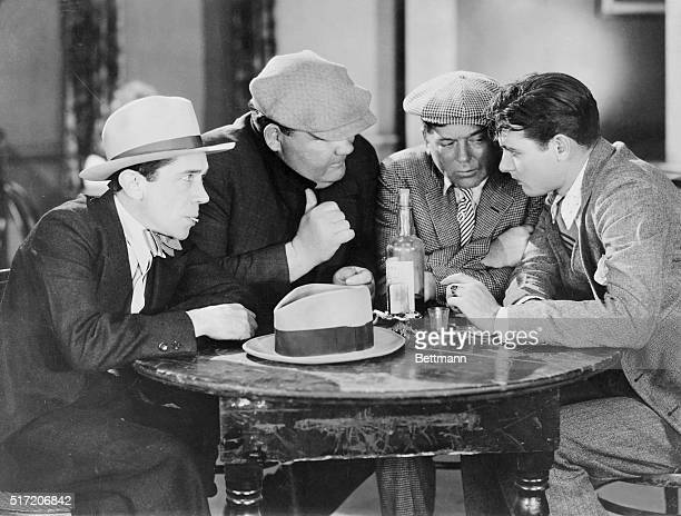 A group of gangsters huddled around a table planning their next crime Movie still from Ladies of the Mob with Richard Arlen