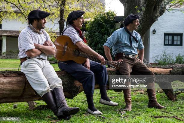group of gauchos laughing after a performance. - argentina traditional clothing stock photos and pictures