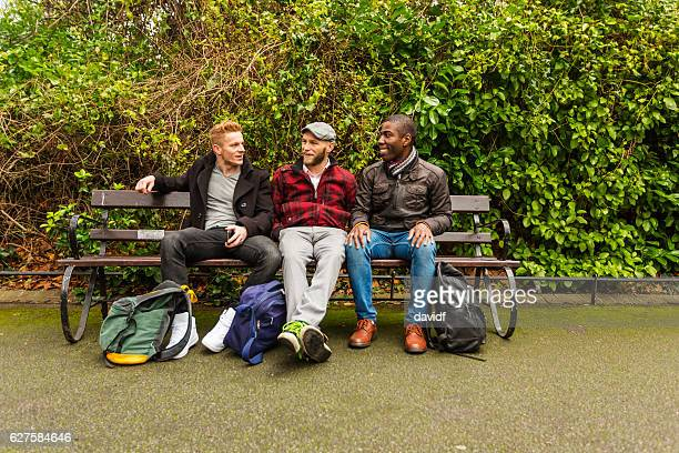 Group of Gay Men Talking in a Park