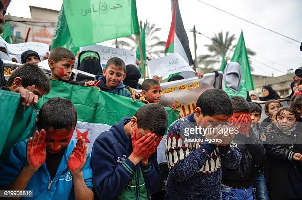 A group of Gazan children stage a demonstration against Assad regime forces' and its supporters' attacks on civilians and the humanitarian plight in...