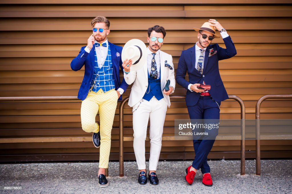 Group of gentlemen are seen during Pitti Immagine Uomo 92. at Fortezza Da Basso on June 14, 2017 in Florence, Italy.