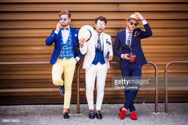Group of gentlemen are seen during Pitti Immagine Uomo 92 at Fortezza Da Basso on June 14 2017 in Florence Italy