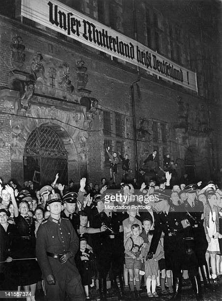 A group of German civilians and soldiers of the SS listening to a speech by Goebbels the banner says Our homeland is called GermanyáGdansk 17th June...