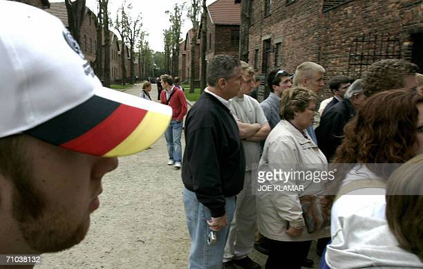 A group of German pilgrims line up to see the execution wall at the Nazi's concentration camp of Auschwitz 24 May 2006 prior to the upcoming visit of...