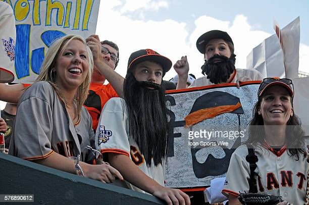A group of Giants fans particularly Giants relief pitcher Brian Wilson as they wear faux beards during a regular season game between the San...