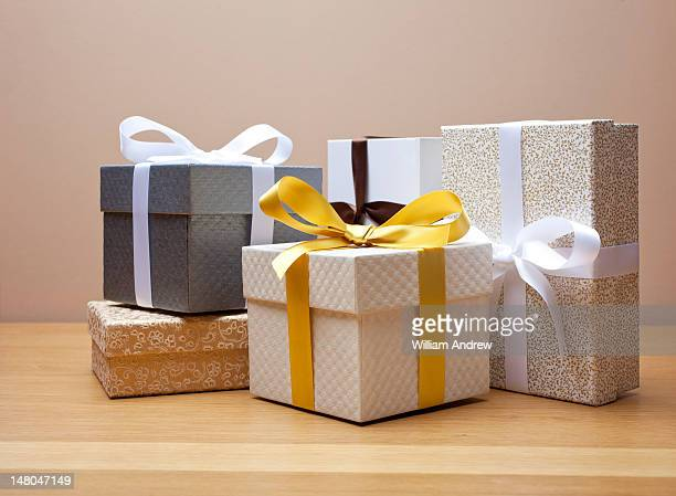 Group of gift boxed presents with bows,