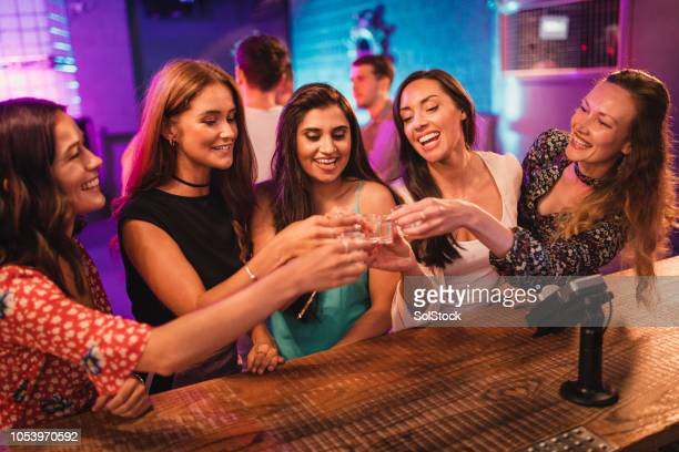 Group of Girls About to take a Shot