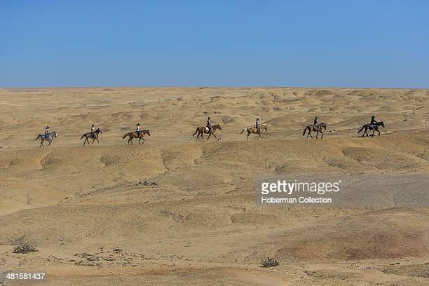 A Group Of Girls And A Man Riding Horses On A Trail At Swakopmund In Namibia