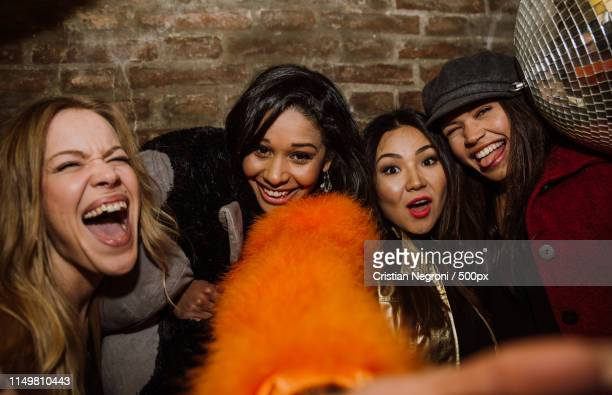 group of girls celebrating and having fun the club concept abou - girls flashing camera stock pictures, royalty-free photos & images