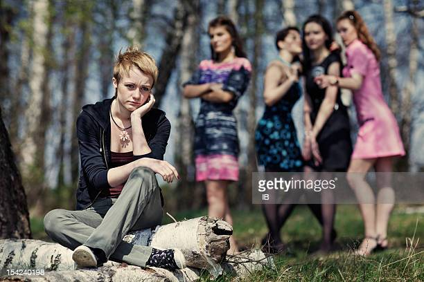 Group of girls discussing the other girl