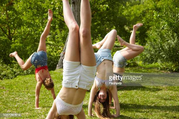 Group of girls doing handstands