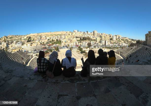 Group of girls enjoys a view from the top of the 2nd-century Roman theatre, a famous landmark in the Jordanian capital, located in the Old Town. On...
