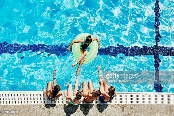 Group of girls hanging out together at pool