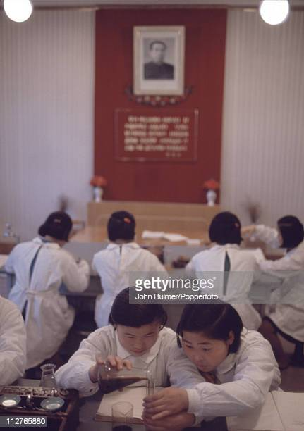 A group of girls in a chemistry class North Korea February 1973 On the wall is a portrait of North Korea's Eternal President of the Republic Kim...