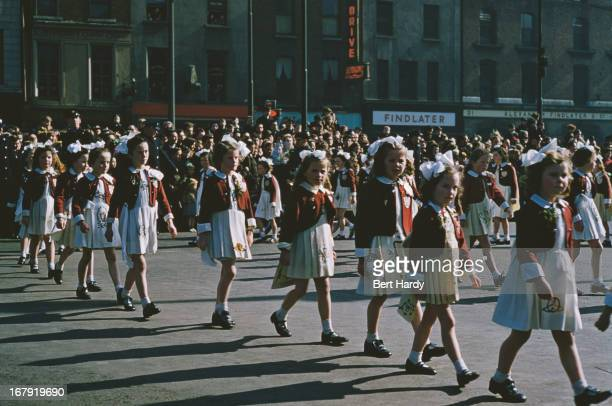 A group of girls in a St Patrick's Day street parade in Dublin Eire 17th March 1955 Original publication Picture Post 7808 Dublin pub 18th June 1955