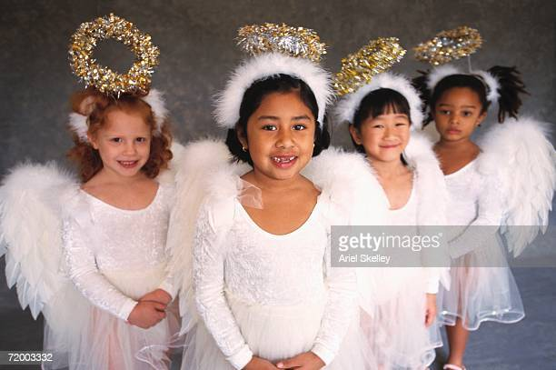 Group of girls in angel costumes smiling