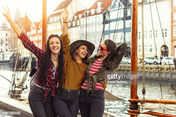 group of girls in copenhagen - nyhavn stock pictures, royalty-free photos & images