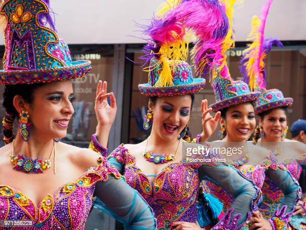 A group of girls in traditional dress dancing 'Morenada' during the grand parade in the downtown of Lima for the 69th anniversary of the National...