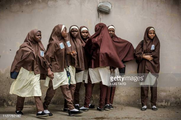 Group of girls leave their school during a rally by All Progressives Congress party supporters celebrating the re-election of the incumbent president...