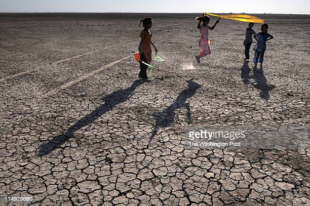 A group of girls play near the newlybuilt Asha Primary School in Little Rann of Kutch The school was built with the hope that parents might send...
