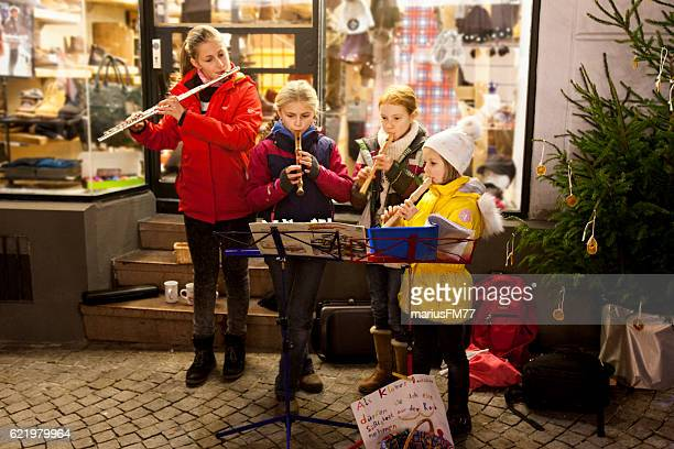 group of girls playing christmas songs