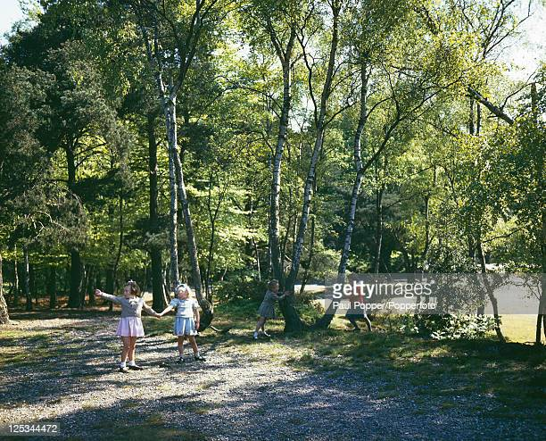 A group of girls playing in woodland on Hayes Common Bromley Kent July 1944