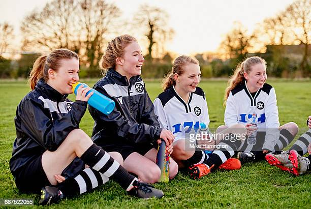 group of girls relaxing after football training - leanincollection stock pictures, royalty-free photos & images
