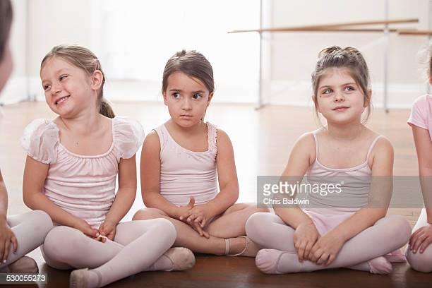 Group of girls sitting on floor in ballet school