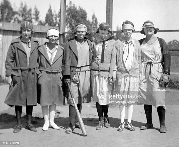 A group of girls stand together before playing a baseball game in California