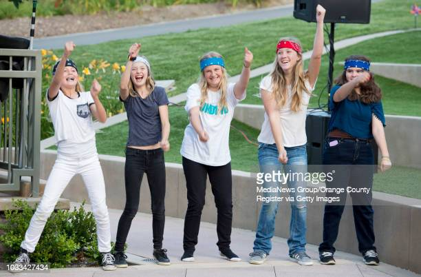 A group of girls the call themselves The Presurettes who are related to the members of the teen band Under Pressure dance during the bands...