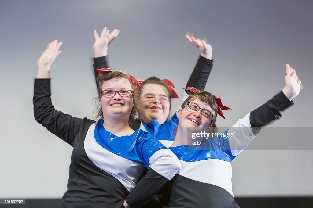 Group of girls with down syndrome on cheerleading squad : Stock Photo