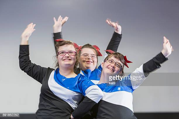 group of girls with down syndrome on cheerleading squad - candid cheerleaders stock photos and pictures