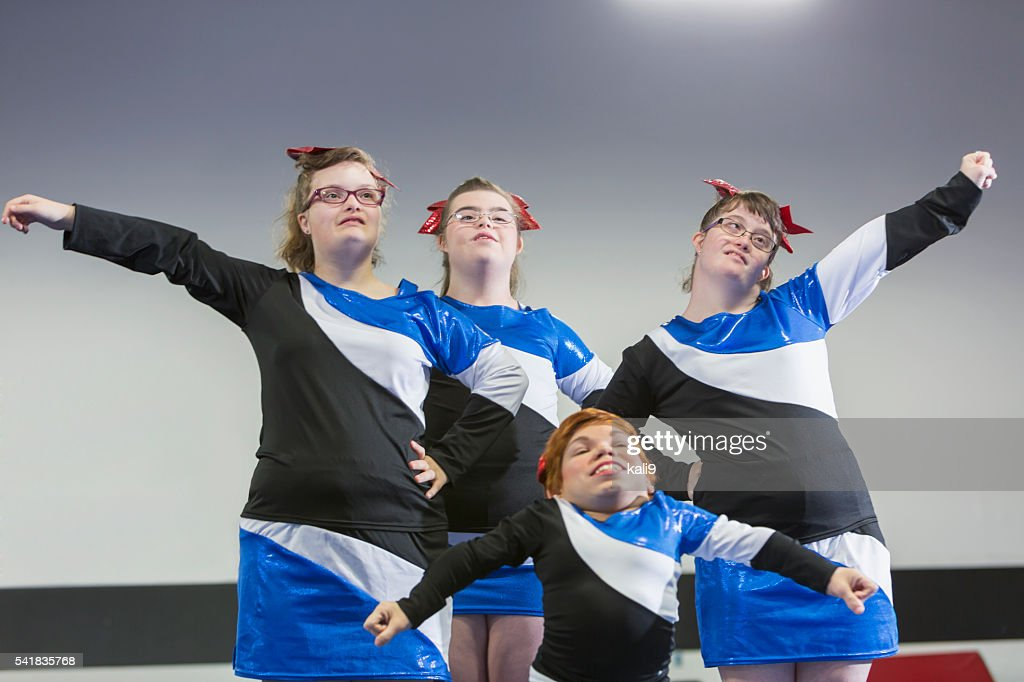 Group of girls with special needs on cheerleading squad : Stock Photo