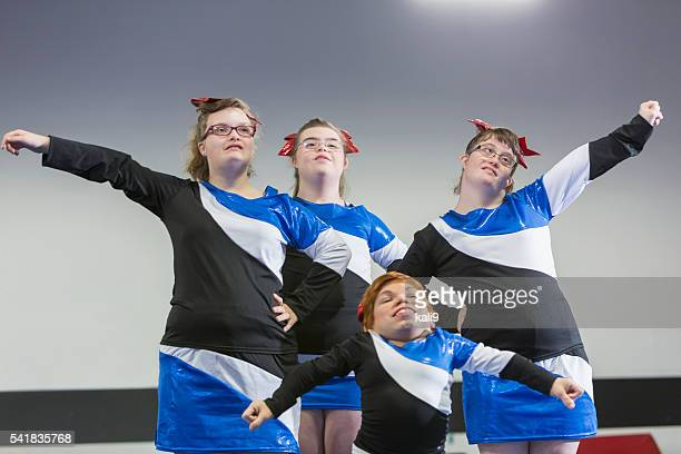 group of girls with special needs on cheerleading squad - candid cheerleaders stock photos and pictures