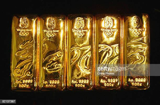 A group of gold bars specially issued for the 2008 Beijing Olympic Games are displayed at a shopping center on February 4 2005 in Beijing China The...