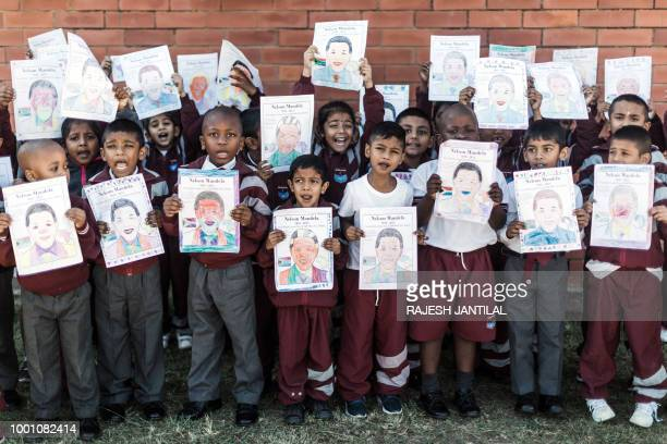 TOPSHOT A group of Grade R learners from Northlen Primary school hold posters of former president Nelson Mandela as they sing 'Happy Birthday Nelson...