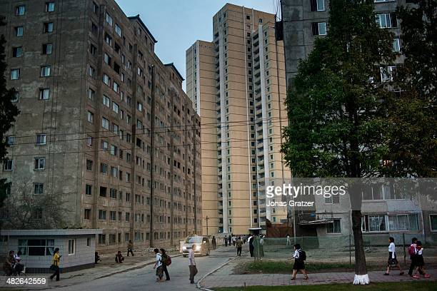 A group of gray concrete buildings in the residential areas of Pyongyang 60 years after the Korean War it is clear that not much has changed in North...
