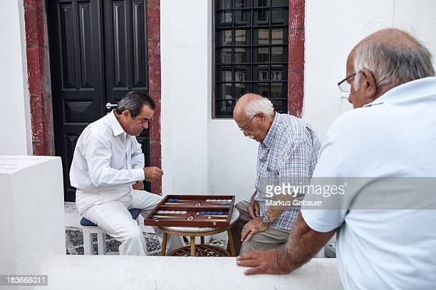 Group of Greece old men playing backgammon.