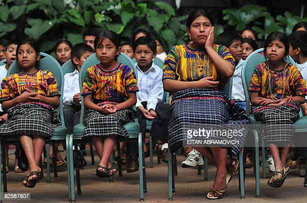 A group of Guatemalan native girls and boys attend the relocation ceremony of the White Rose of Peace the rose is changed every week hosted by the...
