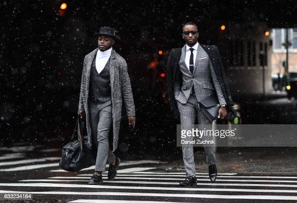 A group of guests are seen wearing a gray striped suits outside of the Carlos Campos show during New York Fashion Week Men's AW17 on January 31 2017...