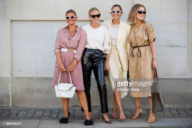 Group of guests seen outside Mykke Hofmann during Copenhagen Fashion Week Spring/Summer 2020 on August 06, 2019 in Copenhagen, Denmark.