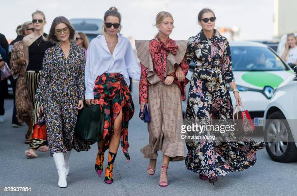 Group of guests wearing dress with floral print outside Stine Goya on August 09, 2017 in Copenhagen, Denmark.